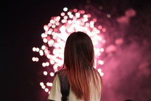 woman looking at fireworks